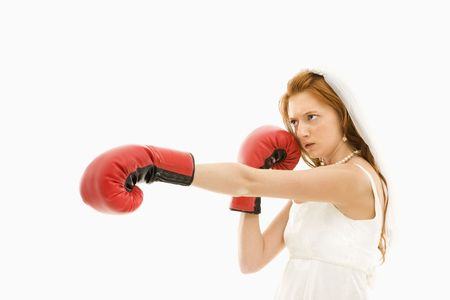 Caucasian bride with boxing gloves. photo