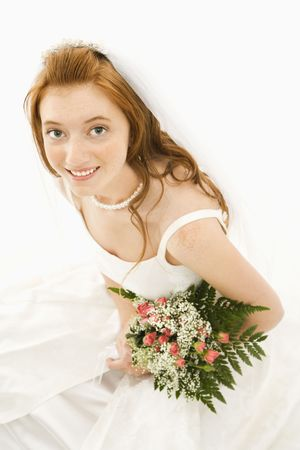 Portrait of a Caucasian bride holding bouquet. photo