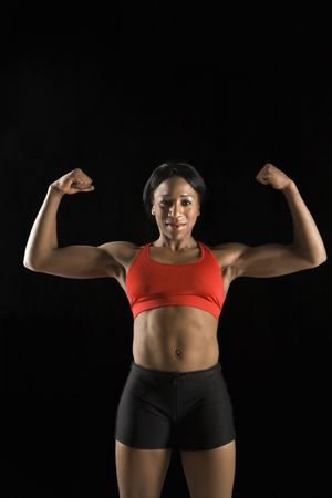 flexed: Muscular African American woman wearing athletic apparel with biceps flexed.