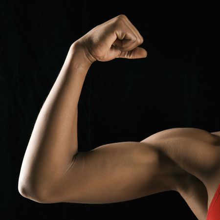 Arm of African American woman flexing muscular bicep. Stock Photo - 2147473
