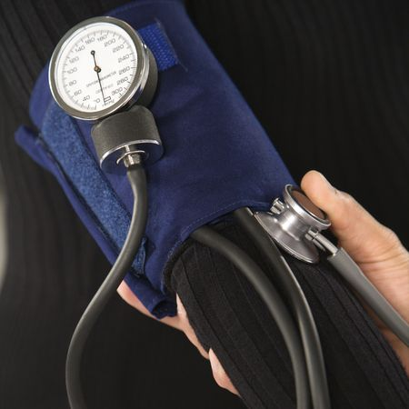 Close up of doctor testing blood pressure of patient. photo