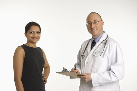 Caucasian mid adult male physician talking with Indian woman patient. Stock Photo - 2191372
