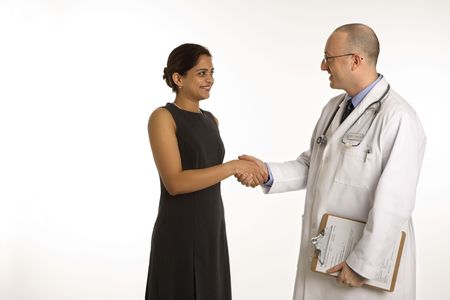 Caucasian mid adult male physician talking with Indian woman patient. photo