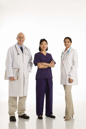 Caucasian mid adult male physician with Asian and Indian women doctors. photo