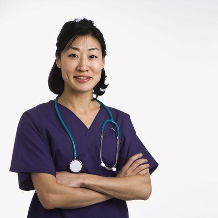 half  length: Asian woman doctor half length portrait against white background. Stock Photo