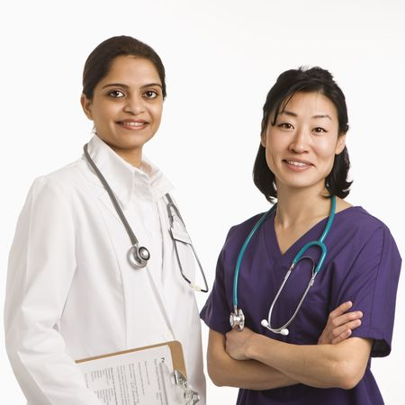 Indian and Asian mid adult woman doctors portrait on white background. Stock Photo - 2190822
