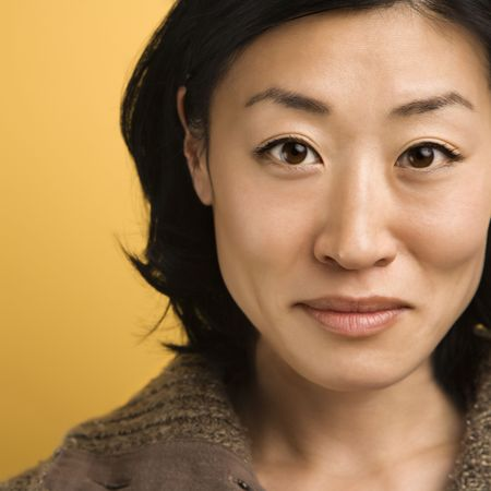 face close up: Close up portrait of mid adult Asian woman.