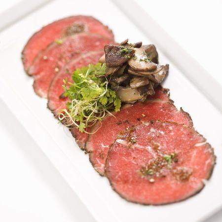 carpaccio: Pepper charred beef carpaccio with mushrooms. Stock Photo