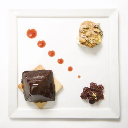 praline: Chocolate cheesecake pyramid with dried cherries and pistachio praline.