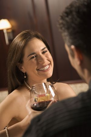 Mid adult Caucasian couple holding wine glasses and smiling. Stock Photo - 2190198