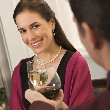 Mid adult Caucasian couple smiling and toasting wine glasses. Stock Photo - 2190289