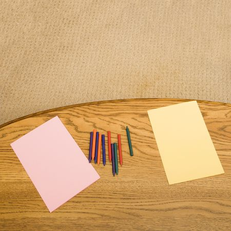 Construction paper and crayons on table. Stock Photo - 2190117