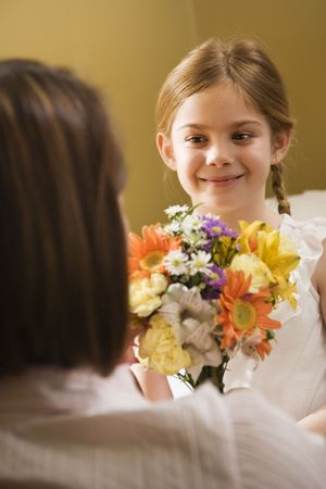 Caucasian girl giving mid adult mother flowers. Stock Photo - 2190775