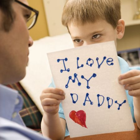Caucasian boy giving mid adult father a drawing. Stock Photo - 2190546