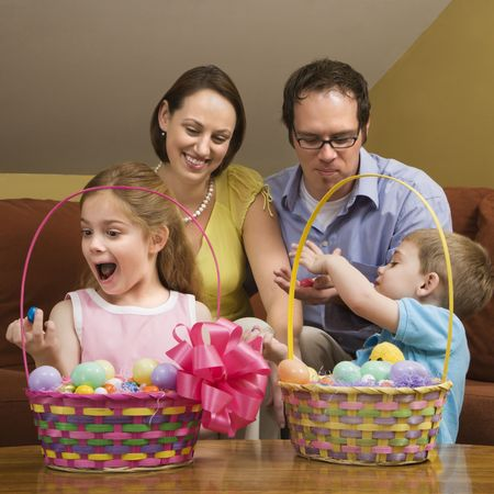 Caucasian family with looking at Easter baskets. photo