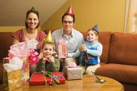 Caucasian family celebrating a birthday party and looking at viewer. photo