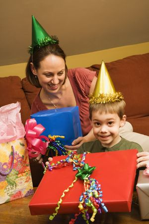 Caucasian mother and son celebrating a birthday party. photo
