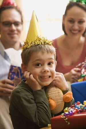 Caucasian boy at  birthday party looking at viewer making facial expression. Stock Photo - 2190307