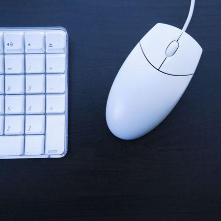 Still life of computer keyboard and mouse. photo