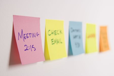 to do list: Sticky notes of to do list on wall. Stock Photo