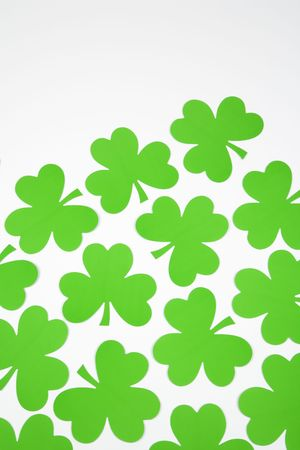 saint paddy's: Group of green paper shamrocks on white.