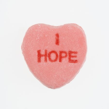 i hope: Pink candy heart that reads I hope against white background.
