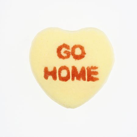 Yellow candy heart that reads go home against white background. Stock Photo - 2191247