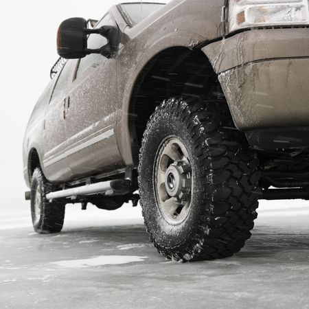four wheel: Low angle of four wheel drive truck on frozen lake in Green Lake, Minnesota, USA.