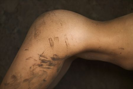 Close-up of young womans muddy torso.  Stock Photo