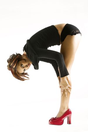 Studio portrait of young Caucasian woman bending over. Stock Photo