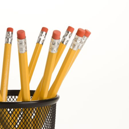 ends: Group of pencils in a pencil holder with eraser ends up.