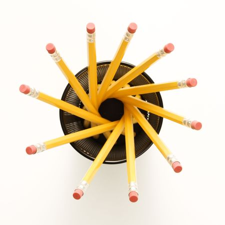 Top view of group of pencils in pencil holder arranged in a spiral shape. photo