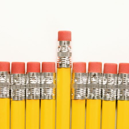 than: Even row of eraser ends of pencils with one raised higher than the rest.