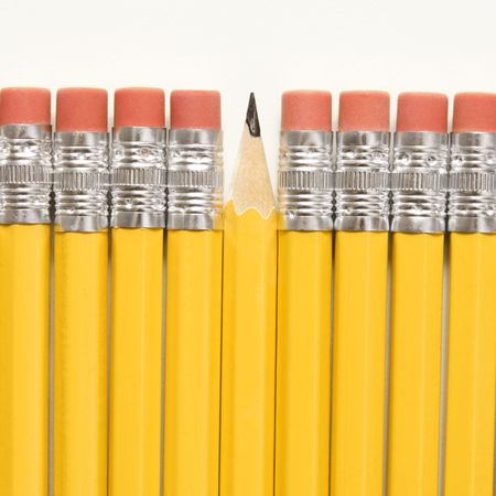 nonconformity: Even row of eraser ends of pencils except for one that has the pointed end up.