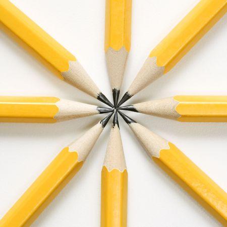 Sharp pencils arranged in a symmetrical radial star shape. photo