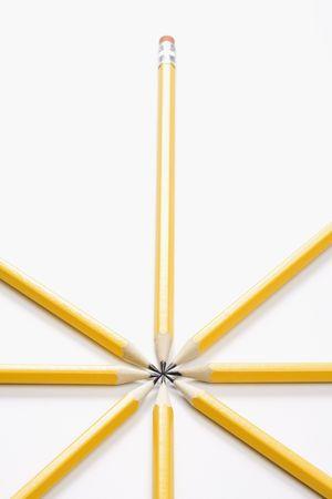 arranged: Sharp pencils arranged in a symmetrical radial star shape.