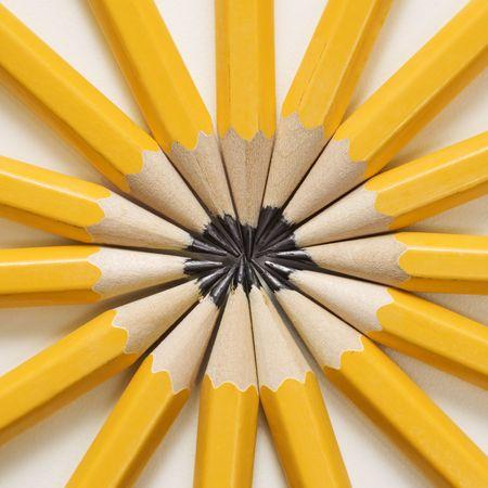 office supplies: Sharp pencils arranged in a symmetrical radial star shape.