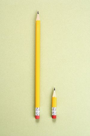 shorter: One long pencil and one short pencil placed side by side in comparison.
