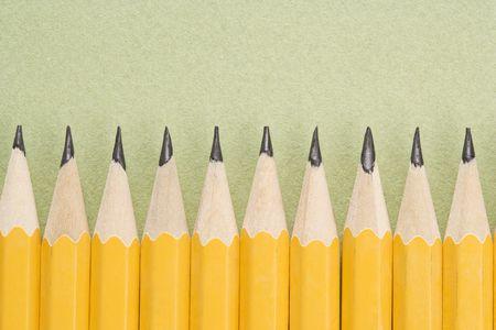arranged: Sharp pencils arranged in an even row.