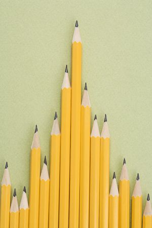 business life line: Sharp pencils arranged in an uneven row. Stock Photo