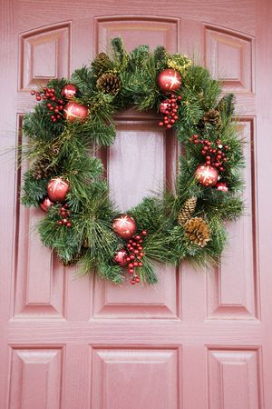 customs and celebrations: Christmas wreath hanging on door.