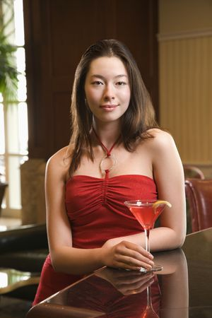 Taiwanese mid adult woman and Caucasian man toasting martinis. Stock Photo - 2204661