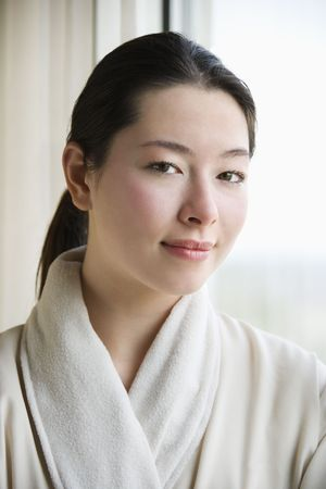 taiwanese: Taiwanese mid adult woman in bathrobe looking at viewer. Stock Photo