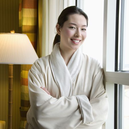 taiwanese: Taiwanese mid adult woman in bathrobe smiling at viewer with arms crossed. Stock Photo