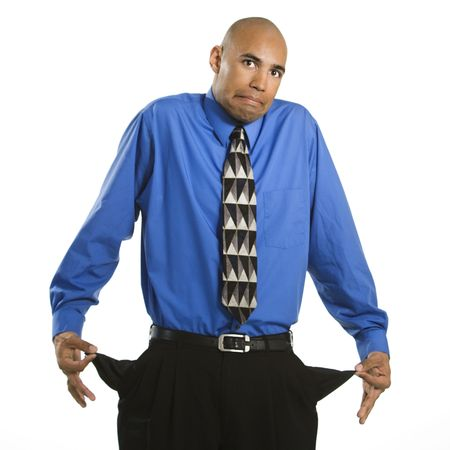 shrugging: African American man in suit pulling out empty pockets and shrugging.