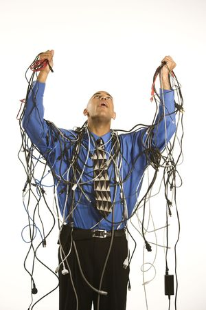 African American businessman wrapped in computer cables. photo