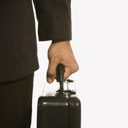 African American businessman in suit holding briefcase. photo