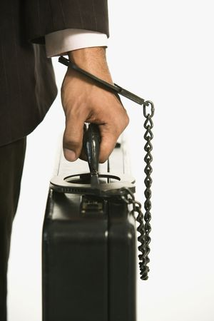 African American businessman in suit handcuffed to briefcase. Stock Photo - 2176316