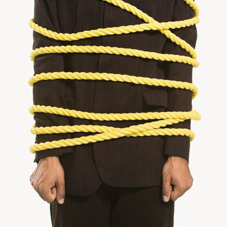 African American businessman wrapped in yellow rope. Stock Photo - 2176093