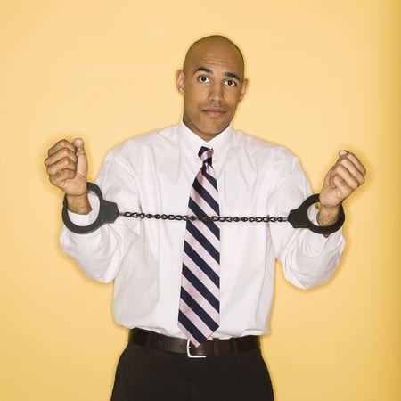 African American man wearing handcuffs. photo